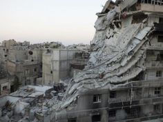 A general view shows buildings damaged by what activists said was shelling by forces loyal to Syria's President Bashar al-Assad in the Al-Khalidiya neighborhood of Homs, June 28, 2013.