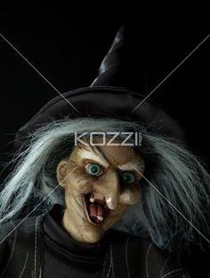 close-up shot of a witch. - Close-up shot of a witch against dark background.
