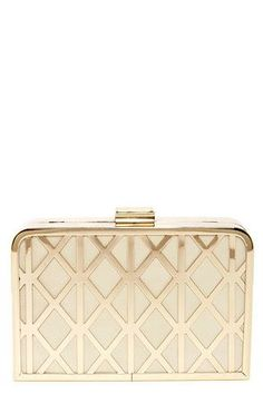 8b33ea7e2 The Trellis Lover Cream and Gold Clutch is trimmed in gold metal over  padded cream vegan leather with a lovely trellis-like design at front.