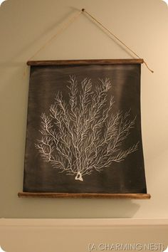Easy Art Board…use a white paint pen, chalkboard fabric, stained dowel rods, jute twine, and upholstery tacks.
