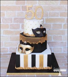 Masquerade themed cake in white, black and gold…