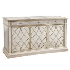 Mirrored credenza with lattice-detailed panels.Product: CredenzaConstruction Material: Wood and mirrored glass