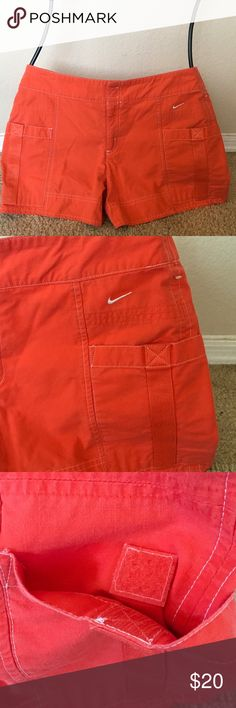 """NIKE Orange Cute SHORTS Velcro Pockets Zip Cotton Comfy cotton solid orangey red shorts w Velcro deep front pockets. BAck is flat...NIKE craftsmanship & gr8 style.... size 4/6 31"""" fully around waist....9 3/8"""" RISE 12 1/2"""" T-B ⛳️🤸🏼♂️🚴🏼♀️🤺🎣🏌️♀️👙👒🕶👓 Nike Shorts"""