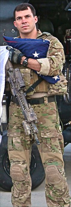 Army Airborne Ranger Colby Bradley holds 'With Valor,' which he had carried on a number of missions in Afghanistan.