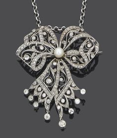 An early 20th century diamond brooch/pendant, circa 1905  The articulated pierced and millegrain-set rose-cut diamond tied ribbon bow of foliate design, set to the centre with a 5.2mm. pearl and terminating with collet-set old brilliant-cut diamond tassels, length 5.8cm.