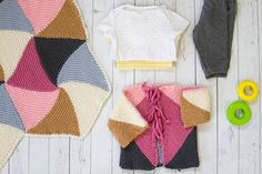 The Abella Baby Set combines several colors of Valley Superwash in geometric shapes that comprise both the baby blanket and the cleverly designed cardigan.