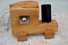 Wooden iPhone station with lamp. The silver circle is a light not a speaker. Would be cooler to be both.