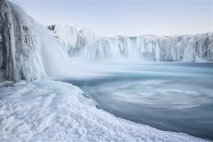 Godafoss Waterfall is encrusted in ice, Myvatn, Iceland.