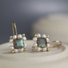 An especially unique design, these handmade Victoria earrings are set with beautifully rich and striking faceted labradorite at the center in a square shape. Around the center stone features hand woven pearls and gold filled beads. Labradorite Jewelry, Gemstone Earrings, Stud Earrings, Dior Earrings, Diamond Earrings, Crown Earrings, Purple Earrings, Cluster Earrings, Wire Earrings