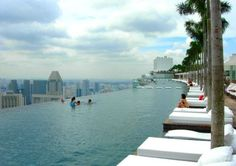 Marina Bay Sands, Singapore  This is the Marina Bay Sands  incredible infinity pool, floating  a staggering 656 feet (200 metres) up in the sky. The pool spans across the top of the resort's three futuristic hotel towers as a part of the hotel's Sands SkyPark
