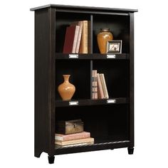 The Edge Water Bookcase features cubbyhole storage for books, binders, framed photos, collectibles, and more.  Accomodates ID label tags.  Estate Black finish.