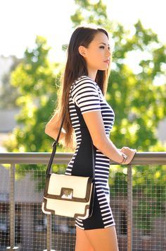 Jessica R is wearing a black and white striped dress from TopShop and a bag from Express