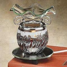 StealStreet SS-A-59205 Electric Oil Burner Collectible Incense Burner, Aromatherapy Decoration, http://www.amazon.com/dp/B002WPMI2E/ref=cm_sw_r_pi_awdm_Ol3uwb07M4FJV