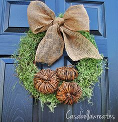Add pumpkins to moss & burlap wreath