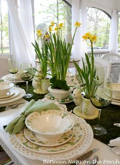 Easter table setting using daffodils and moss.  |  Between Naps on the Porch blog