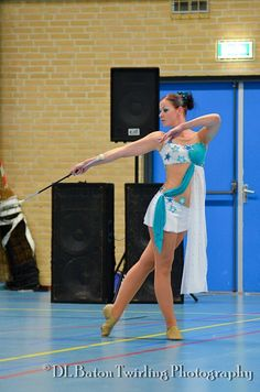 Love her outfit...love that she's an adult twirler, too.  Inspiration for the rest of us.