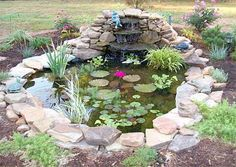 Small garden pond with cascading fountain