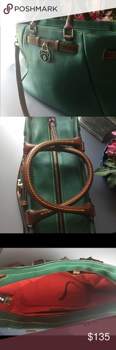 """Dooney & Bourke Leather handbag EUC Dooney & Bourke Forrest Green Samba leather, belted detail, double handles, adjustable and detachable shoulder strap, hanging metal logo lock, four bottom feet, top zipper closure Lined interior, two front-wall slip pockets, one back-wall zip pocket, one back-wall slip pocket, key keeper Measures approximately 15""""W x 11""""H x 5""""D with a 19-1/2"""" to 21-1/2"""" strap drop and 5"""" handle drop; weighs approximately 3 lbs, 2 ozs Body/trim 100% leather; lining 100%…"""