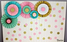 Learn how to make paper rosettes with this step by step tutorial. They make a beautiful party backdrop or add a fun pop of color and texture to any room!