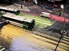 In Sao Paulo a group of activists tipped out several buckets of colorful paint on a much used junction and started in that way the great process of an urban live painting, using cars, bikes and pedestrians as brushes, spreading the paint all over the streets!