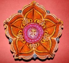 Item: Empty Terracotta Diya    Details: Big empty 5-Wick (Multidirectional) Terracotta Diya    Color: Multicolored, Oil Paint    (The actual products may look different in color, texture, and size from the digital images. Zoom images may take time to display.)    Price: INR: 160        Item #: SU36