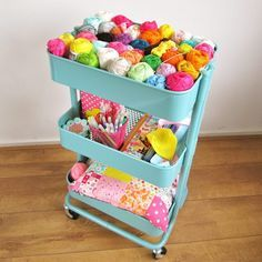 an ikea raskog cart full of colourful yarn and crochet supplies