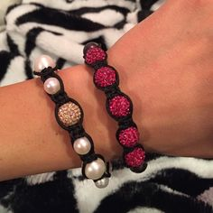 Beautiful bracelet duo! White and gold bracelet and pink and black both with real swarovski crystals! Pull ties to adjust on and off, both never worn! Jewelry Bracelets