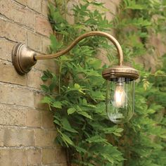 Look for electric outdoor lighting ideas with our beautiful, vintage-style, flat mounted Stable Garden Wall Light in brass, for your garden or porch. Porch Lighting, Exterior Lighting, Outdoor Lighting, Garden Wall Lights, Window Furniture, Modern Rustic Homes, Natural Building, Curtain Poles, Stables