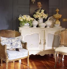 This buffet top is full of objects, but not cluttered - the color (creamy white) unifies the display.