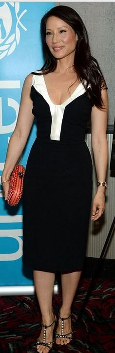 Who made Lucy Liu's black dress, studded sandals, and orange woven clutch handbag that she wore in New York on June 26, 2014?