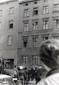 7 October 1961: Four-year-old Michael Finder of East Germany is tossed by his father into a net held by residents across the border in West Berlin. The father, Willy Finder, then prepares to make the jump himself.