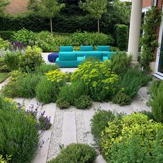 A garden fit for all the family's needs, we supplied the striking aqua blue sofas that look stunning on the new terrace paved in English limestone terrace… Garden Inspiration, Garden Ideas, Terrace Garden, Outdoor Furniture Sets, Outdoor Decor, Looking Stunning, Surrey, Stepping Stones, Garden Design