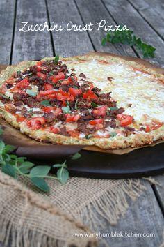 Zucchini Crust Pizza - 8c shredded zucchini, 1c shredded cheddar cheese, 2/3c flour or almond flour, 2 cloves garlic [pressed or minced], 3t dried oregano, 1t basil, 2 beaten eggs, 1/2t salt - Homemade Pizza Sauce: 4 lge tomatoes [quartered], 2T olive oil, 2 garlic cloves [pressed or minced], 1T fresh oregano or 1t dried, 1T fresh tyme or 1t dried, 1t salt