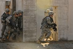 Army paratroopers carry out a combined arms maneuver during a live fire exercise on Fort Bragg, N.C., Dec. 5, 2011. The paratroopers are assigned to the 82nd Airborne Division's 2nd Battalion, 505th Parachute Infantry Regiment, 3rd Brigade Combat Team. The exercise was conducted to ensure that the unit is adequately prepared to deploy on any mission around the world in the event that the global ready force is requested. U.S. Army photo by Joseph Guenther