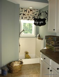 Dog spa mudroom, too cute...love the doggy wallpaper too. via @Dorene Tobler beckley on House Amazing! I was JUST THINKING about a dog wash room in our home!!!! Fabulous!
