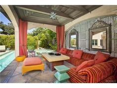 Lounge in this private colorful cabana. This sitting area shows how you can mix bright colors without it being too much!