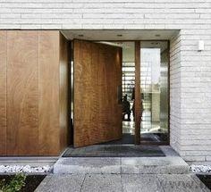 White brick and wood door