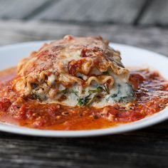 From Chaos In The Kitchen, Single Serving Spinach Lasagna Roll-Ups -  3 cups your favorite marinara or meat sauce 15 oz container ricotta cheese 1 egg or 1/4 cup mayo 6 cups fresh spinach, wilted 1/2 cup Parmesan cheese 6 lasagna noodles, cooked and cooled 8 oz mozzarella, shredded