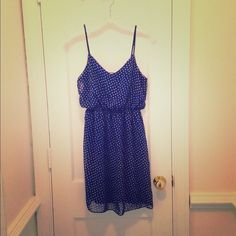 Maitai Blue and Yellow Floral Print Dress Beautiful blue dress with yellow floral print. Very light and flowy . . . perfect for hot summer days or great for fall with a cute jacket and boots. I took the tags off when I bought it but it has never been worn. Maitai Dresses