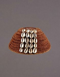 Africa | Hat from the Lega people of DR Congo | Raffia, leather, cowrie shells | Collected in 1910 in Kivu || ©African Museum, Belgium