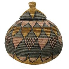 These handwoven baskets are woven by people from the Zulu tribe in the KwaZulu -Natal region of South Africa.The fiber used is from the indigenous illala palm tree and the colors are natural dyes obta