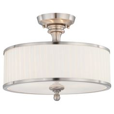 Featuring a brushed nickel finish and pleated fabric shade, this timeless semi-flush mount casts a warm glow in your foyer or dining room.    ...