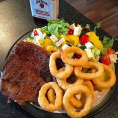 Rest day:  Sirloin steak salad feta onion rings and Jim Beam barbecue sauce.  Calories:820 Fat:42 Carbs:54 Protein:58  #intermittentfasting #fasting #healthy  #bodybuilding #nutrition #workout #leangains #iifym #ifitfitsyourmacros #fit #food #protein #yum
