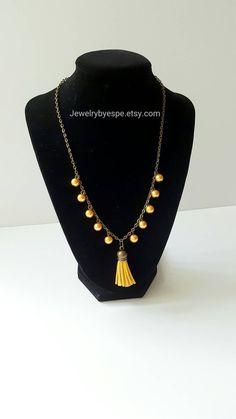 Hey, I found this really awesome Etsy listing at https://www.etsy.com/listing/265276063/mustard-yellow-necklaceleather-tassel