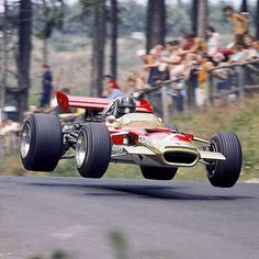 Graham Hill in the Gold Leaf Team Lotus 49 flies through the air on the way to place at the German GP at the Nurburgring… F1 Lotus, Aryton Senna, Racing Car Design, Formula 1 Car, Classic Motors, Indy Cars, F1 Racing, Car And Driver, Vintage Racing