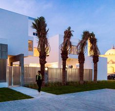 Vertical aluminium slats screen the exterior and windows of this house in Kuwait by Studio Toggle