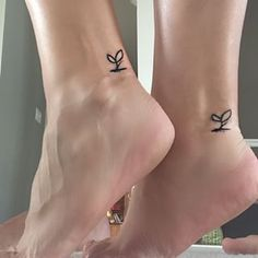 when your tattoo makes it to @buzzfeed / For nature enthusiasts. | 19 Tiny Tattoos You Won't Have Trouble Committing To / mother daughter tatttoo / sprout / tiny tattoo / tiny ink