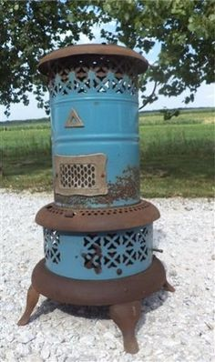 I just bought one of these at an antique store in Placerville. Love it (we just use it as a decoration). Oil Heater, Stove Heater, Antique Wood Stove, How To Antique Wood, Distressed Wood Furniture, Kerosene Heater, Old Stove, Cottage Fireplace, Vintage Stoves