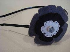 Bandolete com flor de feltro industrial