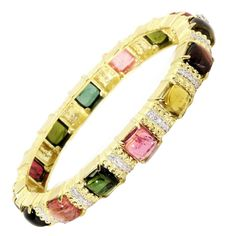 For Sale on - gold bangle bracelet with tourmalines and diamonds Diamonds and tourmalines go all the way around total multi-color tourmalines, each. Gold Bangle Bracelet, Diamond Bracelets, Gold Bangles, Jewelry Bracelets, Necklaces, Jewellery, Tourmaline Jewelry, Silver Diamonds, Fine Jewelry